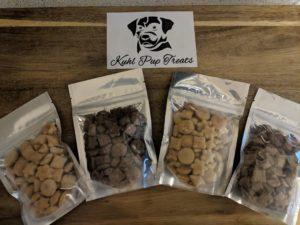 Image of Sample packs of the Khul Pup Treats. 4 small packages with different flavors.
