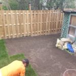 Jasmine the dog's back yard, Mark is lying sod down after building a very big wood fence.